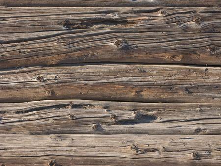 Fragment of old weathered log wall background