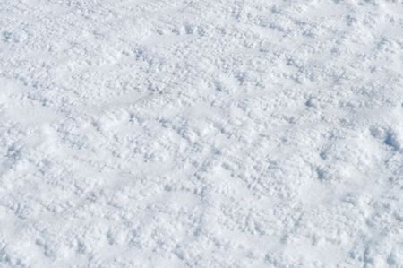 Close up of snow surface texture on sunny day