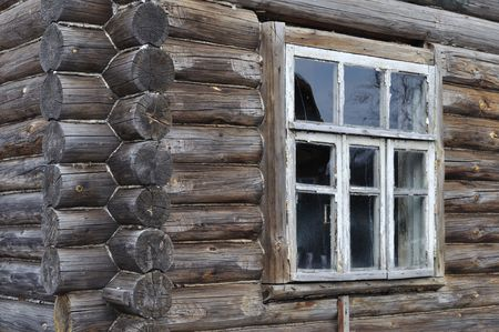 Fragment of old wooden house wall with window photo
