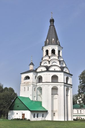 Medieval bell tower and church in monastery of Alexandrov town, Russia