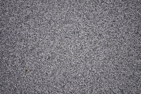 dissimilar: Close up of decorative grey wall from a granite crumb Stock Photo