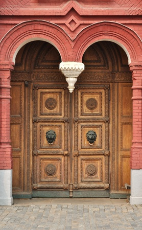 Old massive wooden door with lions, Historical museum in Moscow, Russia Stock Photo