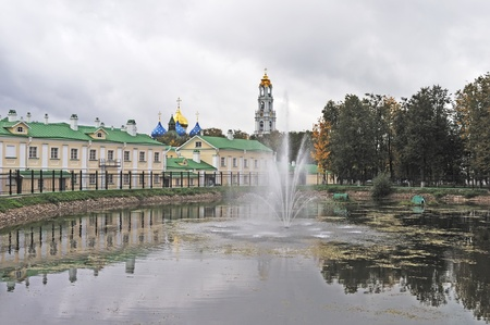 monastic: View of monastic pond with fountain in autumn, Sergiev Posad city, Russia