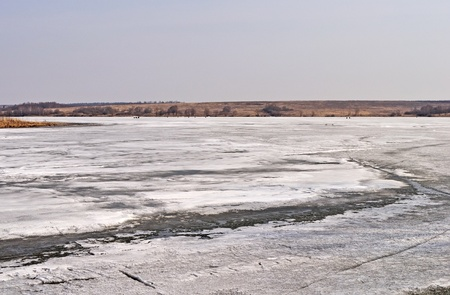 Country landscape with melting ice on a river in early spring Stock Photo