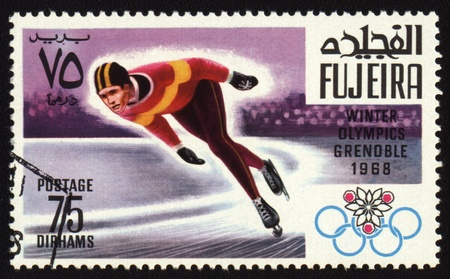 Postage stamp from Fujeira shows Winter Olympic Games in Grenoble 1968. Skater