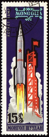 Postage stamp printed in Mongolia shows rocket start, circa 1963