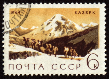 USSR - CIRCA 1964: stamp printed in USSR, shows mountain landscape with Kazbek peak, Caucasus, circa 1964 Stock Photo