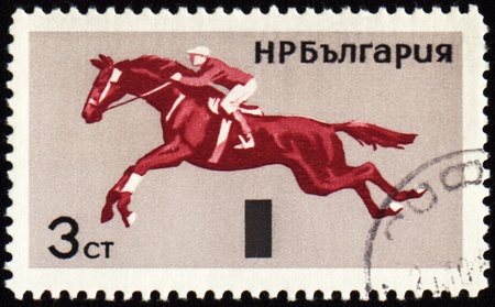 BULGARIA - CIRCA 1965: stamp printed in Bulgaria, shows equestrian sport, show jumping, circa 1965