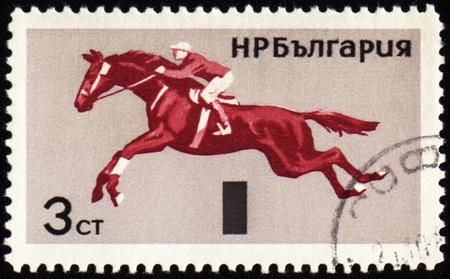BULGARIA - CIRCA 1965: stamp printed in Bulgaria, shows equestrian sport, show jumping, circa 1965