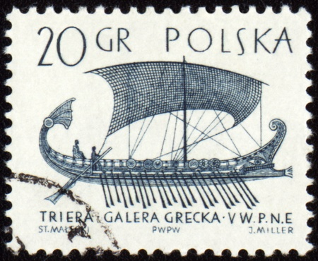 POLAND - CIRCA 1963: stamp printed in Poland shows ancient greek galley Trier, circa 1963 photo