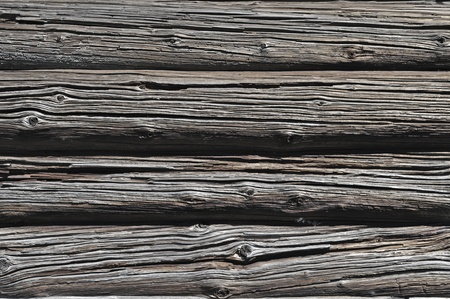 Fragment of log wall background of old wooden barn