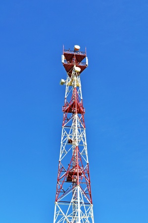Mast cellular with microwave link antennas over a blue sky