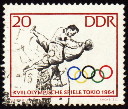 GDR - CIRCA 1964: A post stamp printed in GDR (East Germany), shows judo, devoted Olympic games in Tokio, series, circa    1964 Editorial