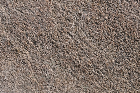 Fragment of natural brown stone surface texture