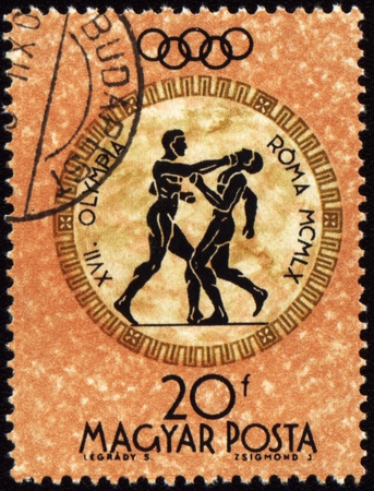 ancient olympic games: HUNGARY - CIRCA 1960: A post stamp printed in Hungary shows boxing, devoted Olympic games in Rome, series, circa 1960 Editorial