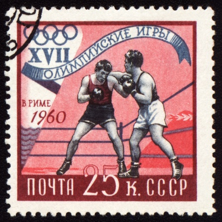 olympic game: USSR - CIRCA 1960: A post stamp printed in USSR shows boxing, devoted Olympic games in Rome, series, circa 1960