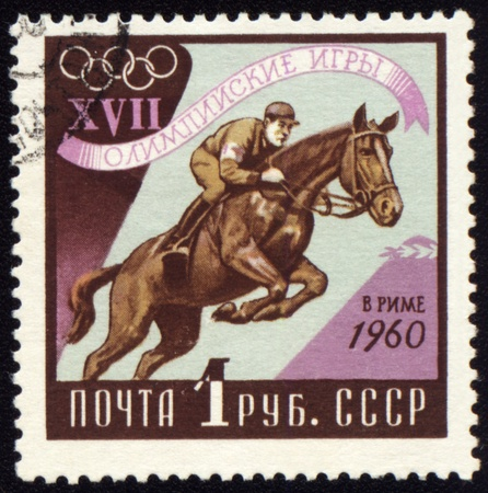 USSR - CIRCA 1960: A post stamp printed in USSR shows horse jumping show, devoted to Olympic games in Rome, series, circa 1960