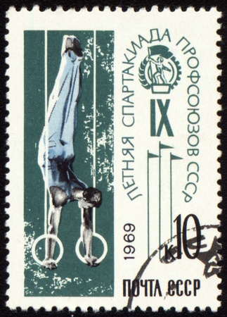 canceled: USSR - CIRCA 1969: A stamp printed in USSR shows gymnast on rings, devoted Olympics of the USSR, circa 1969 Stock Photo