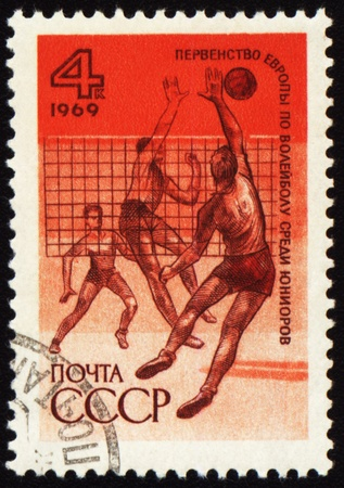 USSR - CIRCA 1969: A stamp printed in the USSR shows volleyball competition, circa 1969 Stock Photo - 10178989