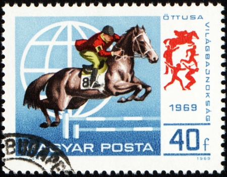 HUNGARY - CIRCA 1969: A stamp printed in Hungary shows horse jumping show, circa 1969