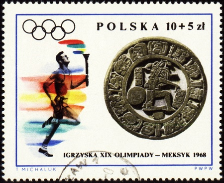 POLAND - CIRCA 1968: A post stamp printed in Poland shows sportsman with torch, devoted to Olympic games in Mexico, series, circa 1968 Editorial