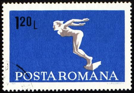 ROMANIA - CIRCA 1969: A post stamp printed in Romania shows diving swimmer, series, circa 1969 photo