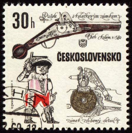 CZECHOSLOVAKIA - CIRCA 1969: stamp printed in Czechoslovakia shows ancient pistol, series, circa 1969 photo