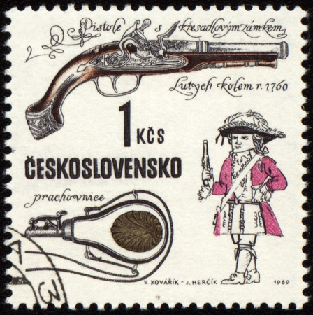jackboots: CZECHOSLOVAKIA - CIRCA 1969: stamp printed in Czechoslovakia shows ancient pistol, series, circa 1969