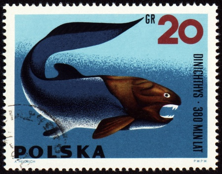 POLAND - CIRCA 1966: stamp printed in Poland shows a prehistoric fish Dinichthys, series Zoolith, circa 1966 photo