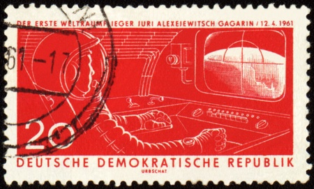 gagarin: GDR - CIRCA 1961: A post stamp printed in GDR (East Germany) shows first astronaut Yuri Gagarin in spacecraft cabin, circa 1961 Stock Photo