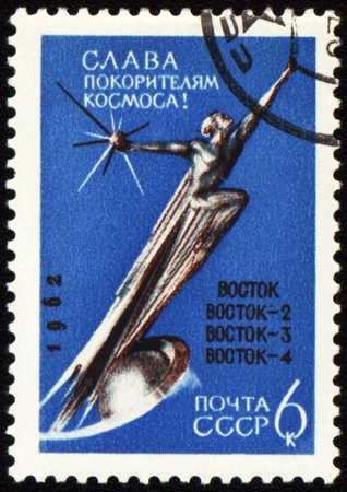 vostok: USSR - CIRCA 1962: A stamp printed in USSR shows Conquerors of Space Monument, devoted to the soviet spaceships Vostok series, circa 1962