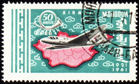 air liner: MONGOLIA - CIRCA 1961: stamp printed in Mongolia, shows flying airplane and map of Mongolia, series, circa 1961 Stock Photo