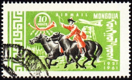 mongol: MONGOLIA - CIRCA 1961: stamp printed in Mongolia, shows Mongolian rider on horse, series, circa 1961 Stock Photo
