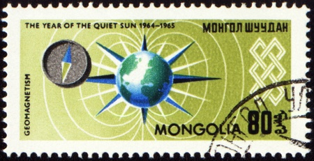 geomagnetic: MONGOLIA - CIRCA 1965: stamp printed in Mongolia, shows geomagnetic field and compass, series The year of quiet Sun, circa 1965