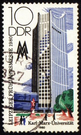 karl: GDR - CIRCA 1980: a stamp printed in GDR (East Germany), shows high-rise building of Karl Marx University, circa 1980