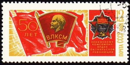 USSR - CIRCA 1968: A stamp printed in USSR, shows banner of komsomol with badge and Order of October Revolution, devoted to the 50-th anniversary of komsomol, circa 1968
