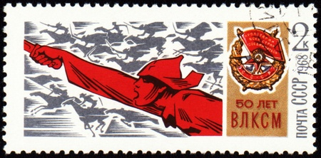 USSR - CIRCA 1968: A stamp printed in USSR, shows riding on a horse soldier with a sword and Order of the Red Banner, devoted to the 50-th anniversary VLKSM, circa 1968 Stock Photo - 10417411
