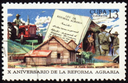 agrarian: CUBA - CIRCA 1969: stamp printed in Cuba shows country life, devoted to the agrarian reform in Cuba, circa 1969 Stock Photo