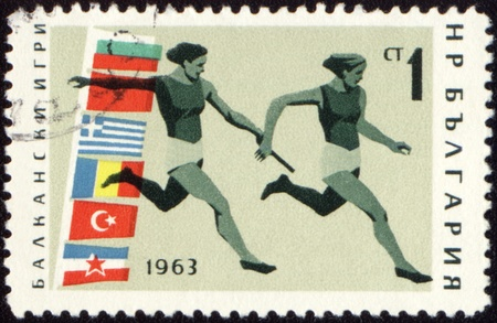 canceled: BULGARIA - CIRCA 1963: A post stamp printed in Bulgaria shows relay race, devoted to Balkan games, series, circa 1963