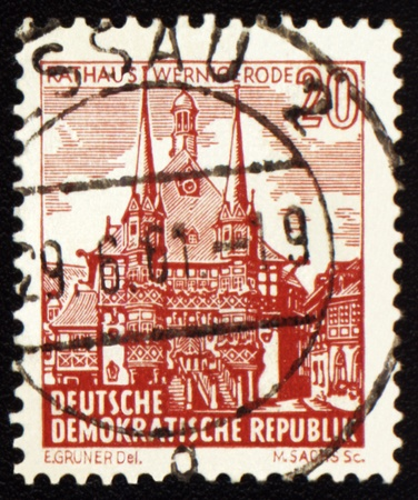 town hall: GDR - CIRCA 1960s: A stamp printed in GDR (East Germany) shows Town Hall of old German town Wernigerode, circa 1960s