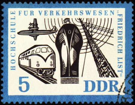 philately: GDR - CIRCA 1962: stamp printed in GDR (East Germany), shows passenger ship, airplane, train and radio-mast, devoted to the Transportation Institute, circa 1962 Stock Photo