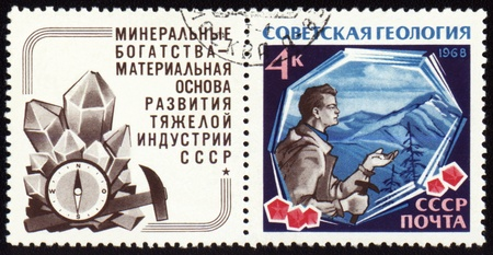 USSR - CIRCA 1968: A stamp printed in USSR, shows geologist on mountains background, devoted to russian geology, circa 1968 photo