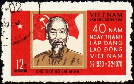 revolutionary war: VIETNAM - CIRCA 1970: A stamp printed in Vietnam shows portrait of Ho Chi Minh, circa 1970 Stock Photo