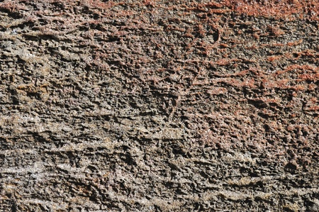 Close up of natural rough brown stone surface photo