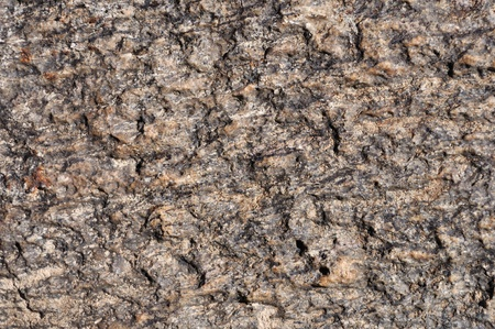 Fragment of natural brown stone surface texture photo