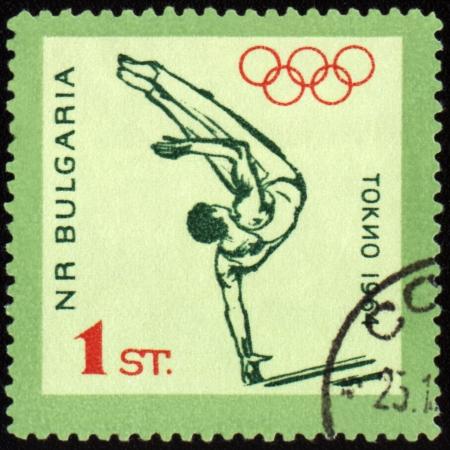 nip: BULGARIA - CIRCA 1964: A post stamp printed in Bulgaria shows gymnastics, devoted to Olympic games in Tokio, series, circa 1964 Editorial