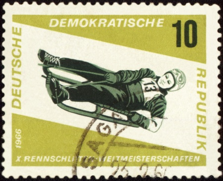 descent: GDR - CIRCA 1966: A stamp printed in GDR (East Germany) shows descent to sledge, circa 1966