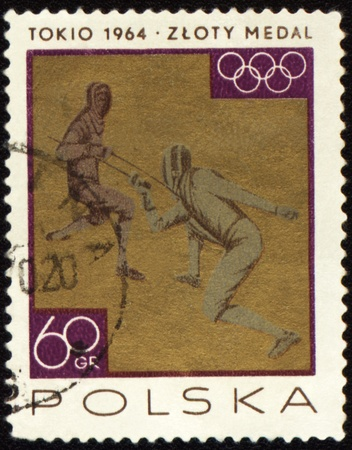POLAND - CIRCA 1964: A post stamp printed in Poland shows two fighting fencers, devoted to Olympic games in Tokio, series, circa 1964
