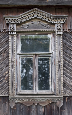 Carved window in old russian wooden country house