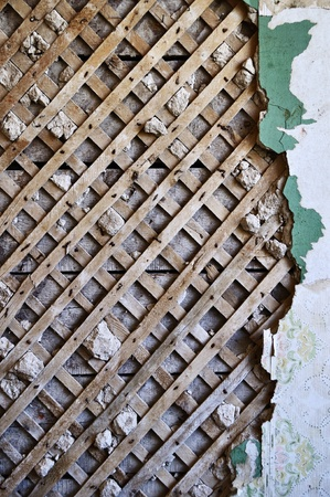 remount: Grunge lath and plaster background on old destroyed wall Stock Photo